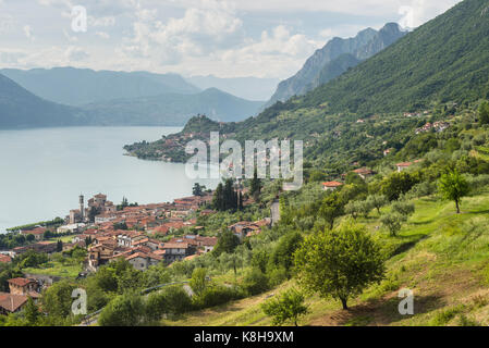 The mediterranean style villages of Sale Marasino and Marone on the shores of Lake Iseo, Lombardy, Italy - Stock Photo