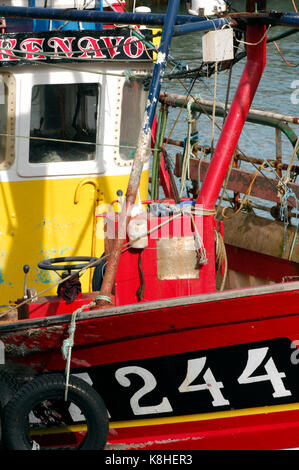fishermens boats in colourful harbour sheltering from the weather. inshore fishing boats in a port docked alongside - Stock Photo