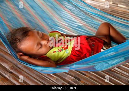 Cambodian baby sleeping in a hammock. cambodia. - Stock Photo