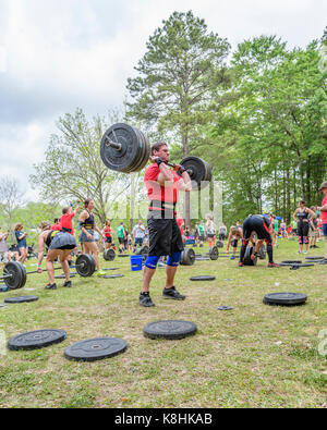 Man lifting weights during the Combat on the Coosa competition which is affiliated with The Garage Games and is - Stock Photo