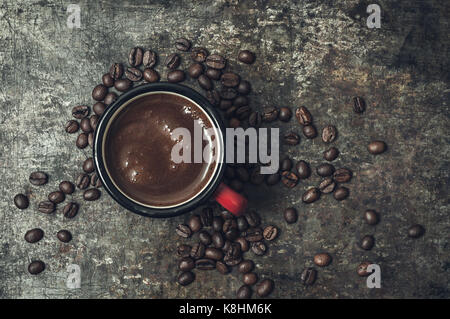 Coffee cup with roasted beans on stone background, from above - Stock Photo