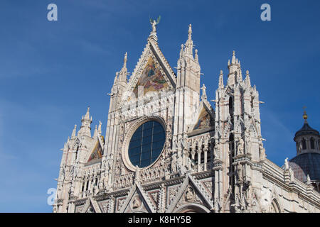 Italy, Siena - December 26 2016: the view of upper facade detail of Duomo di Siena or Metropolitan Cathedral of - Stock Photo