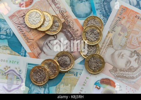 New British currency (one pound coins, five pound and ten pound notes, London, England, United Kingdom - Stock Photo