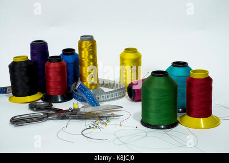 line reels, scissors, metric tape, pin and needles, some of the many necessary tools  for the art of sewing that - Stock Photo