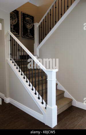 Exceptional An Stairway With Wrought Iron Railing And Carpet Stairs With Globe Art In  The Corner.
