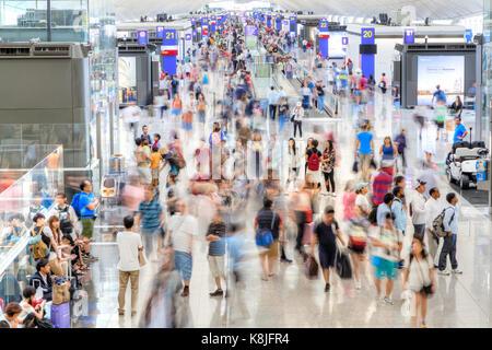 HONG KONG - JULY 16, 2017: Passengers at the departure terminal of Hong Kong Chek Lap Kok International Airport, - Stock Photo