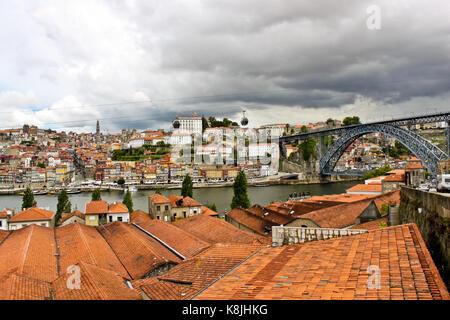 Porto, Portugal - May 20, 2012: View of Porto and Dom Luis I Bridge over river Douro from Vila Nova de Gaia. - Stock Photo