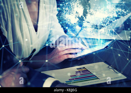Businessperson in office connected on internet network with tablet. concept of partnership and teamwork - Stock Photo