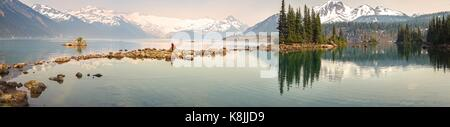 Panoramic Landscape of Garibaldi Lake in Coast Mountains of British Columbia Canada with distant Glacier obscured - Stock Photo