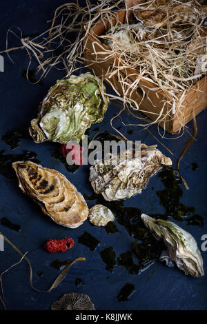 Seafood produce, oysters in a wooden box. Close-up. - Stock Photo