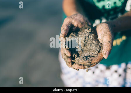 children playing with sand beaches.having fun with family.holiday concept. - Stock Photo