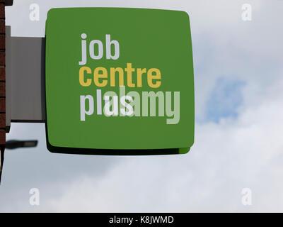 Job Centre Plus sign in Barnstaple, Devon, against a pale sky - Stock Photo