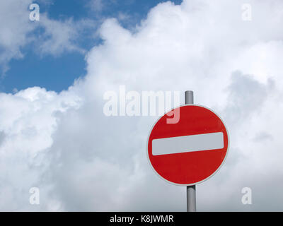 No Entry road sign UK, set against white clouds - Stock Photo