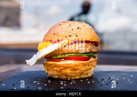 Delicious restaurant hamburger with fried egg - Stock Photo