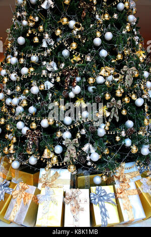 Decorated christmas tree with presents. vietnam. - Stock Photo