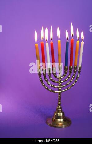 Jewish holiday Hanukkah and its famous nine-branched menorah - Stock Photo