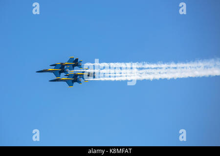 US Navy Blue Angels F/A-18 Hornets flying in formation against a blue sky during the 2017 Chicago Air and Water - Stock Photo
