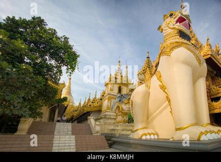 Leogryph guarding the entrance to Shwedagon Pagoda, Yangon, Burma, Myanmar, Southeast Asia - Stock Photo
