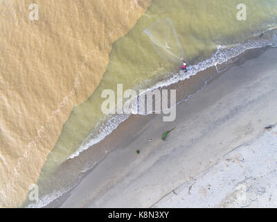 aerial photo - fishermen are fishing by the beach using nets. living concept - Stock Photo