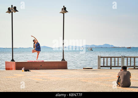 Photographer with model working outdoors. Photographer shooting outside. On location. - Stock Photo