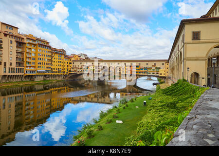 Ponte Vecchio Bridge in a summer sunny day without people - Stock Photo