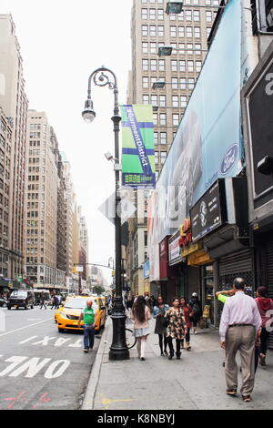 New York, USA -  29 September, 2016: Traffic and Pedestrians on 8th Avenue in Manhattan.