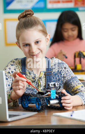 Portrait Of Female Pupil In Science Lesson Studying Robotics - Stock Photo