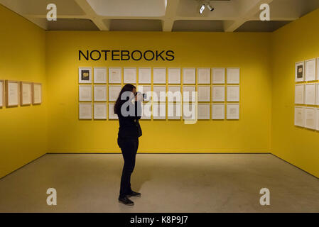 London, UK.  20 September 2017.  A visitor photographs a collection of notebooks by Jean-Michel Basquiat.  Preview - Stock Photo