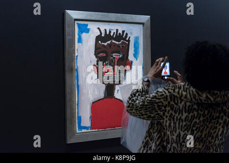 London, UK.  20 September 2017.  A visitor photographs 'Self-Portrait', 1984, by Jean-Michel Basquiat.  Preview - Stock Photo