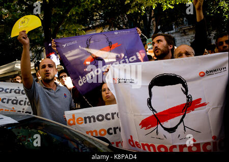 Barcelona, Spain. 20th Sep, 2017. Pro-independence supporters hold banners reading Democracy close to Catalan  Economy - Stock Photo