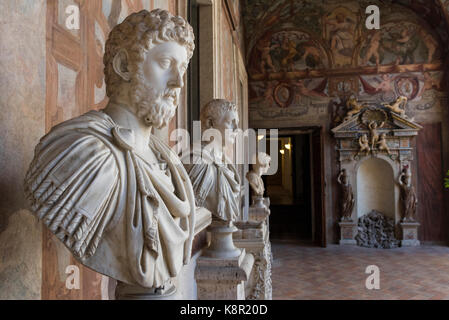 Rome. Italy. Busts of Roman Emperors, (foreground) Emperor Marcus Aurelius, line the loggia of Palazzo Altemps. - Stock Photo