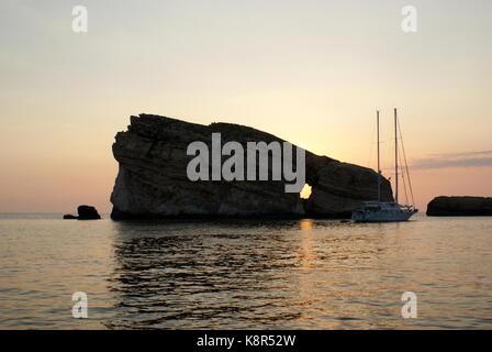 Sun setting behind Fungus rock, Dwejra bay, San Lawrenz, Gozo, Maltese archipelago - Stock Photo