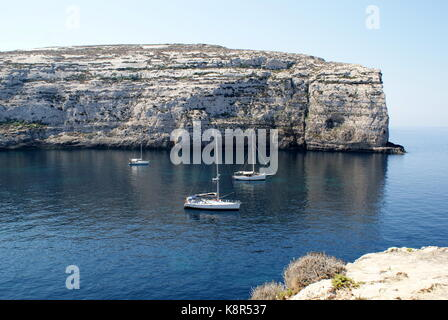 Sailing yachts at anchor in Dwejra bay, San Lawrenz, Gozo, Malta - Stock Photo