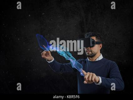Digital composite of man using vr headset pointing - Stock Photo