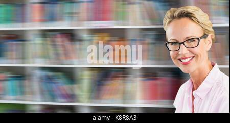 Portrait of smiling confident teacher against shelf of books - Stock Photo
