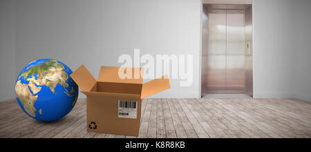 Planet earth and brown box against room with elevator - Stock Photo