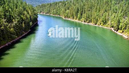 High angle view of boat in river amidst forest during sunny day - Stock Photo