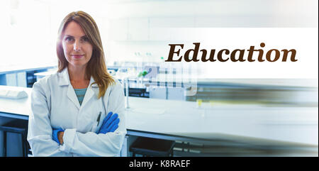 Digitally generated image of Education text  against portrait of smiling scientist standing with arms crossed - Stock Photo