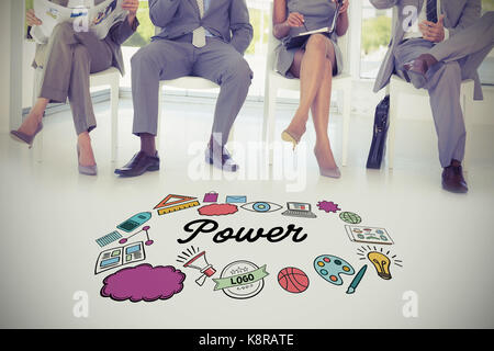 Multi colored power text surrounded by icons against business people sitting on chairs - Stock Photo