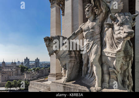 Sculpture in pediment with Tower Bridge in background. Ten Trinity Square - Four Seasons Hotel, City of London, - Stock Photo