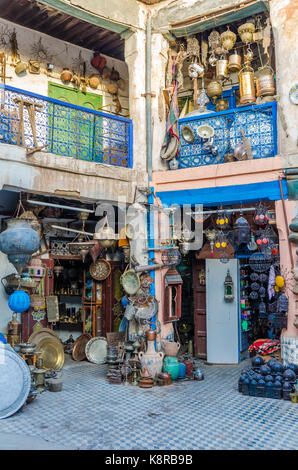 Huge selection of pots, lamps, lantern and other metal works in shop of souk in medina of Fez, Morocco, North Africa. - Stock Photo