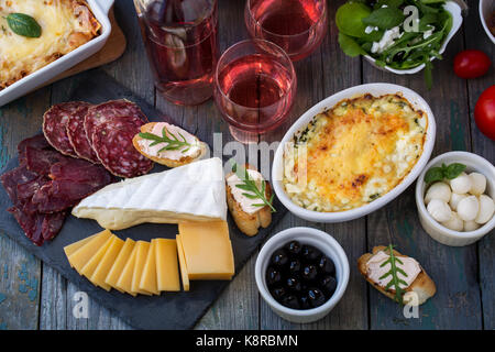Board with delicacies. Top view - Stock Photo