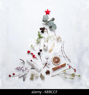 View from above of Christmas tree made of decorations, berries, cinnamon, candles and other festive objects and - Stock Photo