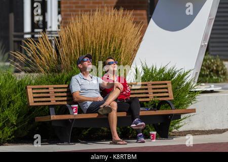 Coeur d' Alene, Idaho - August 21 : Couple enjoying the eclipse together. August 21 2017, Coeur d' Alene Idaho. - Stock Photo