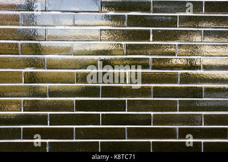 shiny green brick wall - Stock Photo