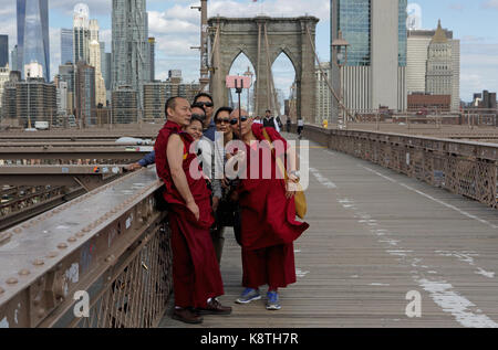 New York, NY, USA - May 3, 2017: Group of Asian people and Buddhist monks in traditional robes take a selfy photo - Stock Photo