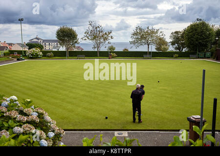 Two men on bowling green at Onchan, Isle of Man - Stock Photo