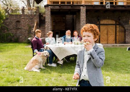 boy eating apple - Stock Photo