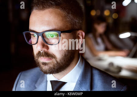 Businessman in the office working at night. - Stock Photo