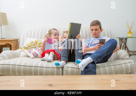 children using technology for gaming - Stock Photo